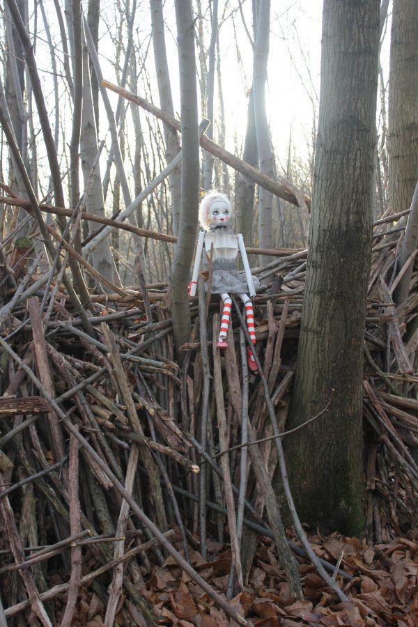 Girl on a Woodpile